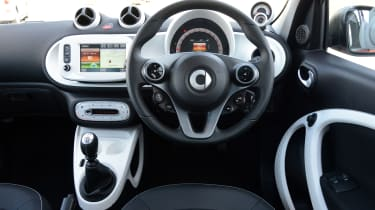 The interior of the Smart ForFour is designed to appeal to younger buyers and it's easy to use.