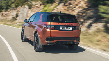 2020 Land Rover Discovery Sport Black - driving rear view