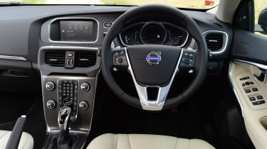 The dashboard is distinctive but shows its age in a high button-count