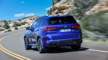 BMW X5 M Competition driving - rear left-hand-side view