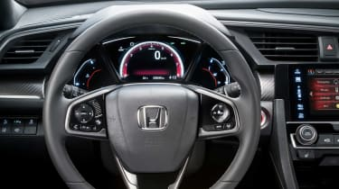 The new Honda Civic's instrument cluster is dominated by a central TFT screen