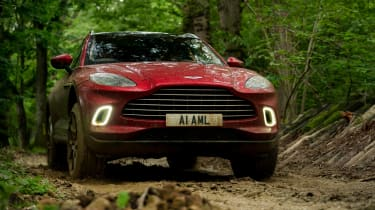 Aston Martin DBX SUV off-road mud front