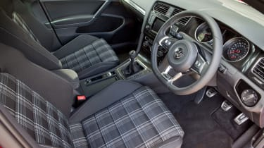 The Tartan-style cloth seat material is a nod towards the Golf GTI