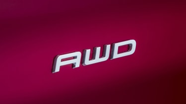 Ford Mustang Mach-E AWD badge