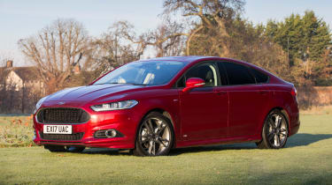 Ford Mondeo hatchback front 3/4 grass