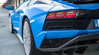 A diffuser at the rear end manages airflow under the car