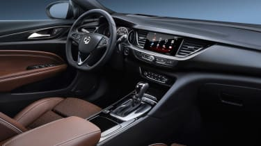 The Insignia Grand Sport is impressively sleek inside, with a frameless touchscreen taking pride of place