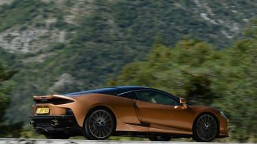 McLaren GT driving past camera