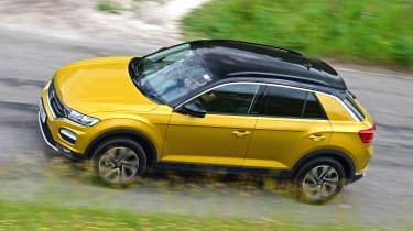 Gold VW T-Roc driving - side view