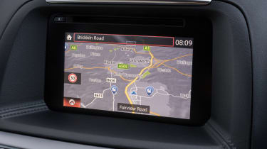 All CX-5s come with sat nav as standard