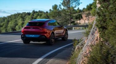 Aston Martin DBX cornering - rear view