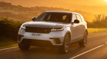 2021 Range Rover Velar P400e plug-in hybrid driving at sunset