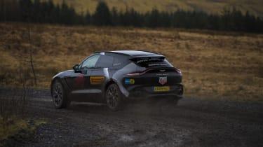 Aston Martin DBX prototype cornering on dirt