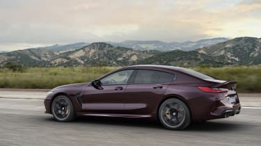 BMW M8 Gran Coupe driving - left side view