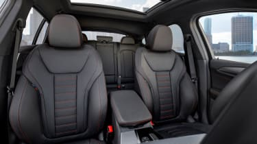 BMW X4 interior shot, front seats, looking towards back