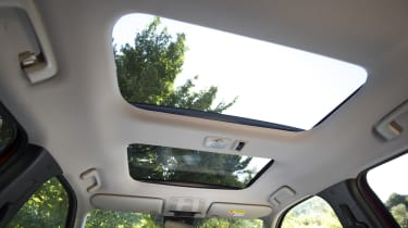 The sunroof doesn't impede badly on headroom, front or rear...