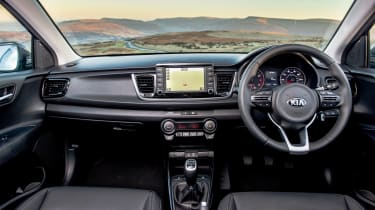 The 3 trim gets faux-leather upholstery and the seven-inch infotainment system with Apple CarPlay and Android Auto