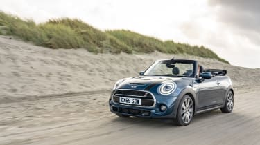 MINI Sidewalk Convertible driving on sand with roof down