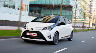Toyota Yaris driving in a city