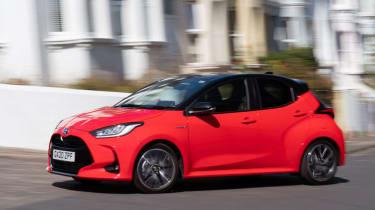 Toyota Yaris hatchback side panning urban