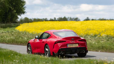 Toyota Supra coupe rear 3/4 country lane
