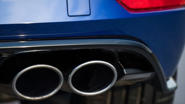 Quad tailpipes remind following traffic that this is no ordinary Golf