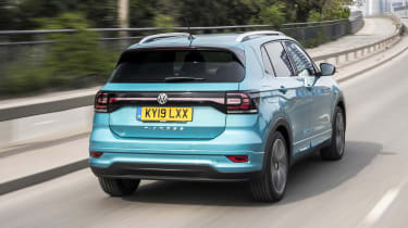 Turquoise VW T-Cross driving - rear