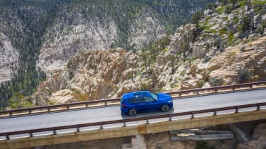 BMW X5 M Competition driving on bridge