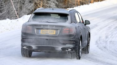 Bentley Bentayga development model driving away from camera