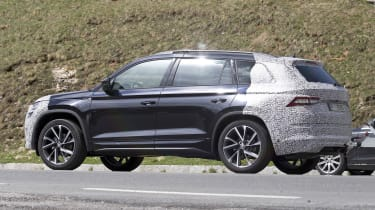 Skoda Kodiaq spy shot driving - side/rear view