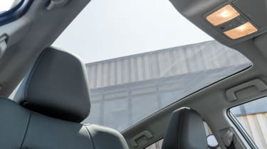 The optional panoramic sunroof floods the cabin with light
