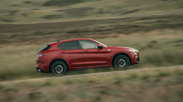 Alfa Romeo Stelvio Quadrifoglio SUV - side view dynamic passing