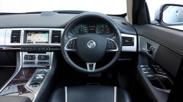 The XF's interior is distinctive & has some neat design touches, while its heated seats are some of the most powerful around