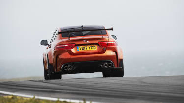 Grip is assured by wide tyres and an adjustable rear wing that provides extra downforce