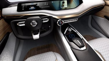 The steering wheel appears to have been chopped in half to give an unobstructed view of the screen