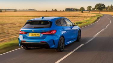 BMW 118i M Sport - dynamic rear 3/4 view