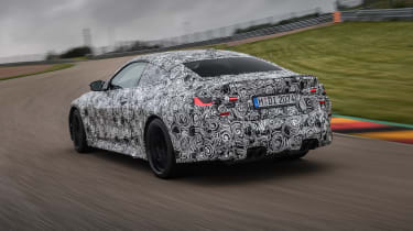 2020 BMW M4 prototype driving - rear view