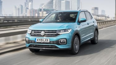 Turquoise VW T-Cross driving