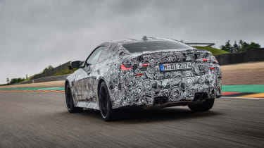 2020 BMW M4 prototype driving on racetrack - rear view