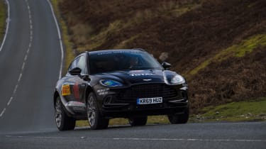 Aston Martin DBX prototype cornering on road - front view