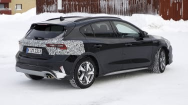 2021 Ford Focus in camouflage - rear side view