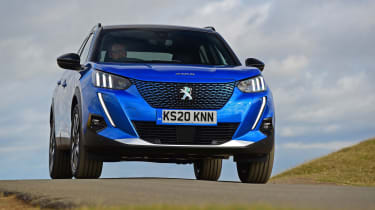 Peugeot e-2008 SUV front driving