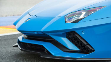 At the nose of the Aventador is an active spoiler