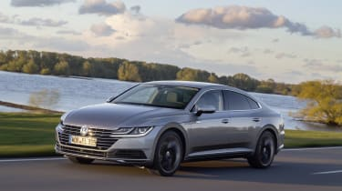 The Arteon features LED daytime running lights that flow from the headlights into a large front grille.