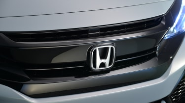 Honda's latest corporate face is evidenced by the new Honda Civic's nose treatment