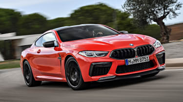 BMW M8 Competition coupe front cornering on track
