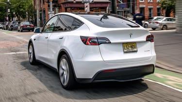 Tesla Model Y SUV rear 3/4 tracking