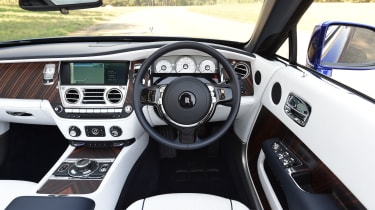 Armchair seats are trimmed in the best leather, and the infotainment system can be hidden behind a wooden veneer until needed