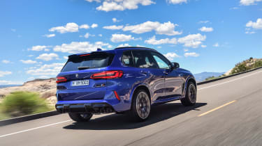 BMW X5 M Competition driving - rear right-hand-side view