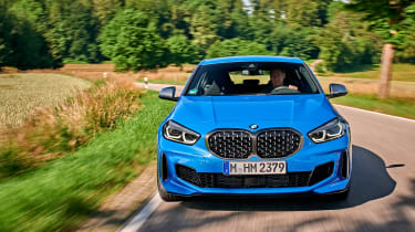 BMW M135i driving - front close up
